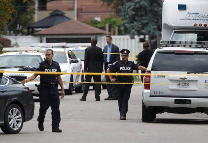 El presunto culpable de la muerte de una mujer y sus dos hijos, fue Brett Ryan, de 35 años, y quien enfrenta tres cargos de asesinato premeditado. ( Archivo/AP)