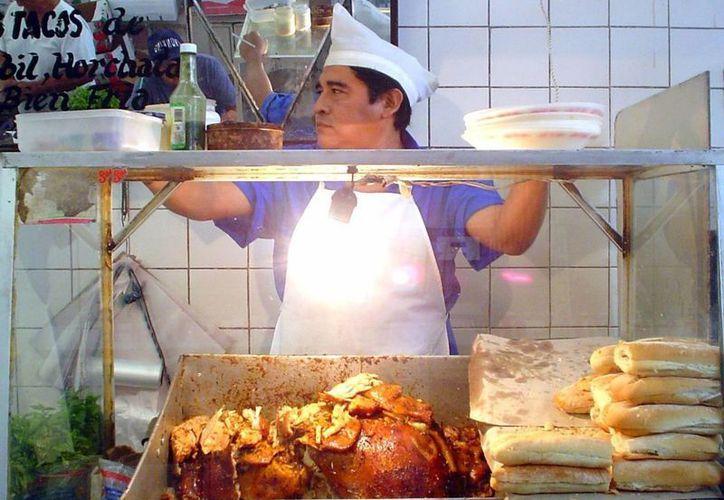 Los tacos y tortas de cochinita pibil son representativos de Yucatán. (Milenio Novedades)