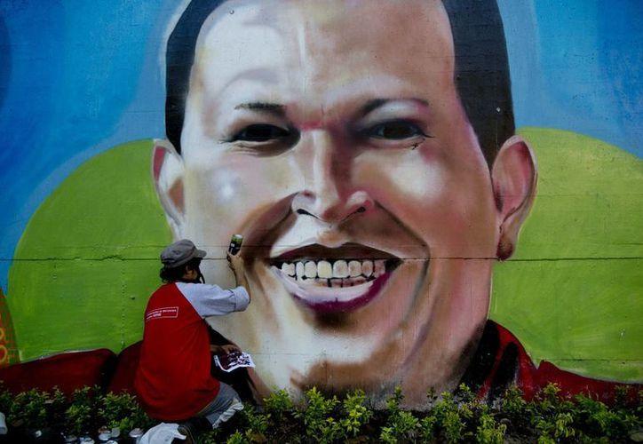 El extinto presidente Chávez aún sigue muy presente en la vida cotidiana de los venezolanos. (Agencias)