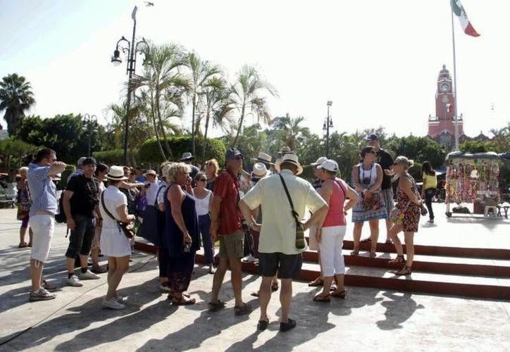 Visitantes se sienten atraídos por el Mundo Maya. (Milenio Novedades)