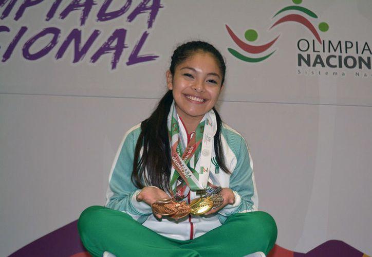 Vanessa Aguilar Tun, campeona de karate por Yucatán, pretende asistir a un torneo en Argentina, pero la Federación le exige 40 mil pesos para pagar su gastos de viaje. (Archivo/Milenio Novedades)