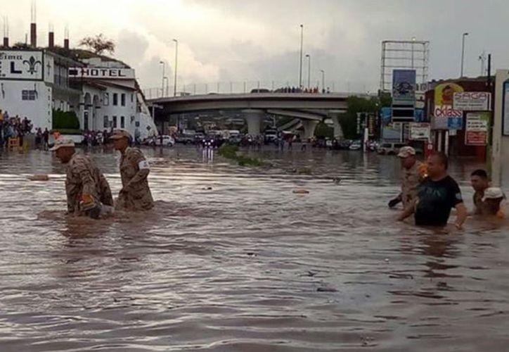 A pesar de haber tenido 37 milímetros de agua, la Unidad de Protección Civil reportó que no existieron pérdidas humanas. (Excélsior)