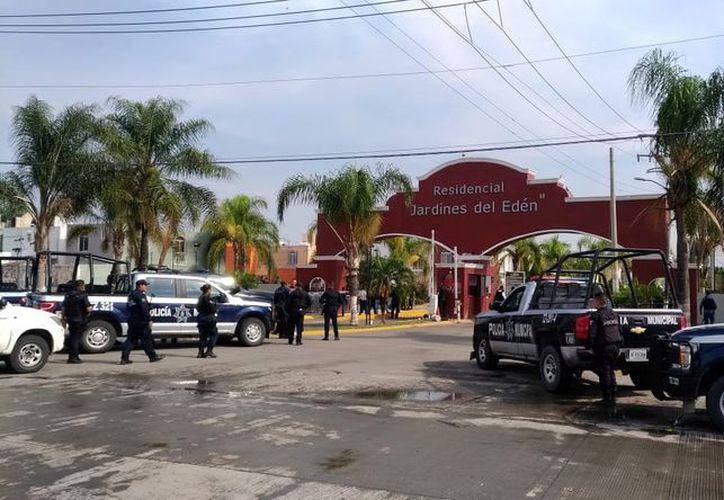 Cerca de las 7:00 horas, patrulleros de Tlajomulco, Jalisco, acudieron al cruce de Eva y Adán para atender el reporte de una agresión a balazos contra unas personas. (Agencia Reforma)