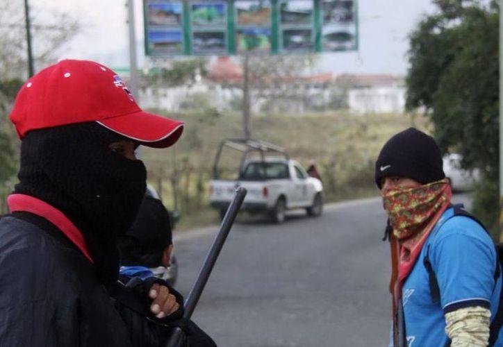 Grupos armados se disputan el control  en la tierra caliente de Michoacán. (Agencias)