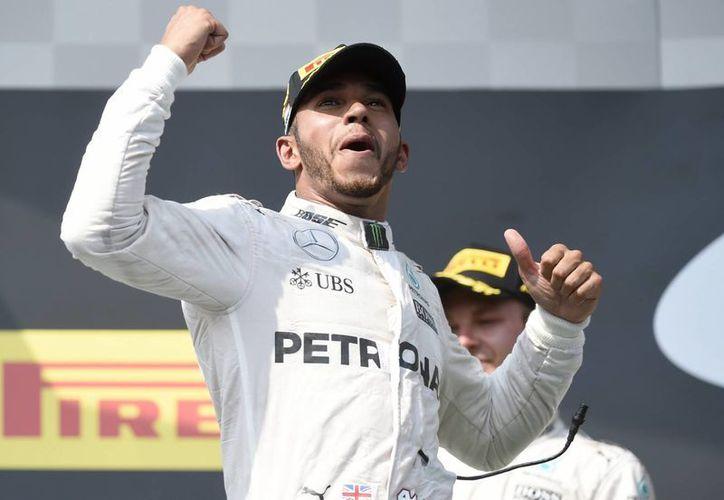 Lewis Hamilton llegó al liderato del mundial de Fórmula Uno con la victoria número 48 de su carrera, que consiguió en el Gran Premio de Hungría. (AP)