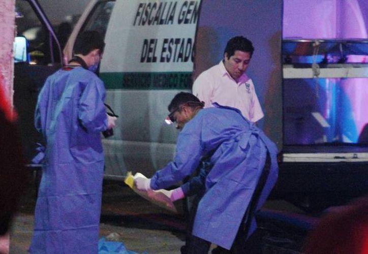 Acusado del homicidio de un 'rival', un integrante de la banda Sur 13 de Kanasín pasará 17 años en la cárcel. La imagen corresponde a la escena del crimen, tomada el 24 de diciembre de 2015 (Archivo/Milenio Novedades)