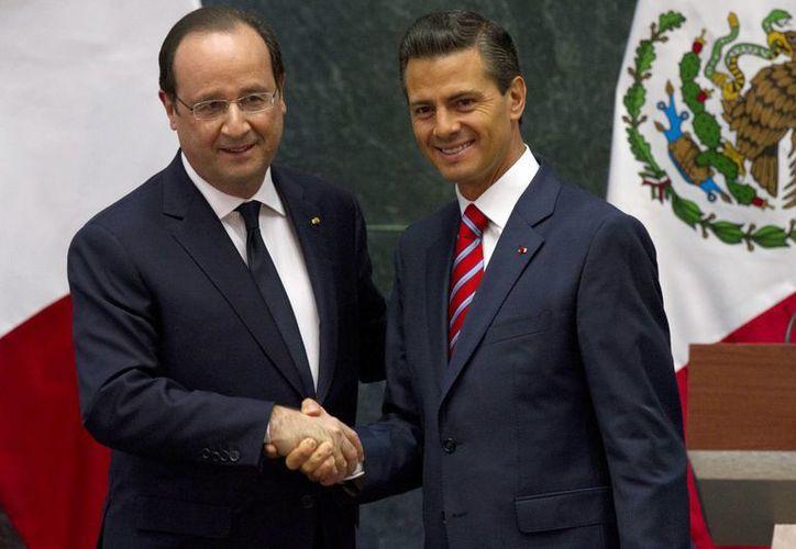 Peña Nieto y Hollande suscribieron 42 acuerdos de carácter estratégico en áreas como energética y la educativa. (Notimex)