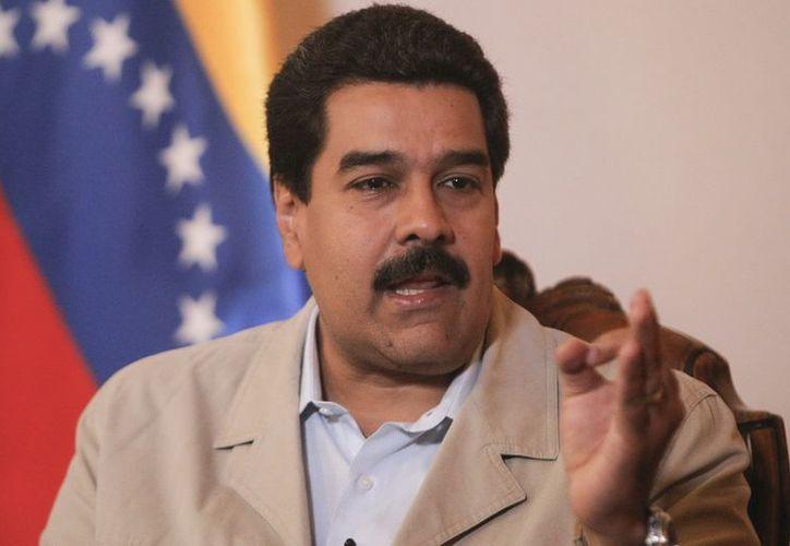 """Nicolás Maduro dijo que en este momento """"no sería posible"""" establecer la fecha del final de la convalecencia del presidente. (EFE)"""