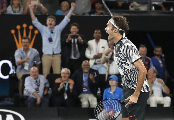 Al adjudicarse el Abierto de Australia, Roger Federer consiguió el Grand Slam número 18 de su carrera. (AP)