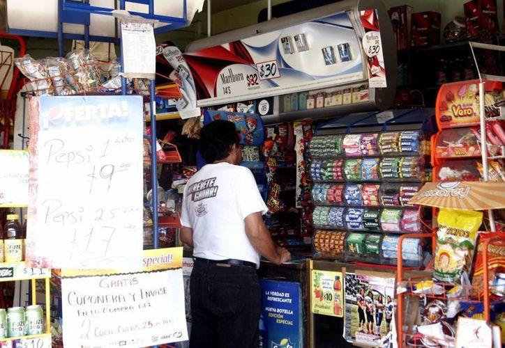 Los pequeños comercios reciben orientación sobre cambios fiscales. (SIPSE)