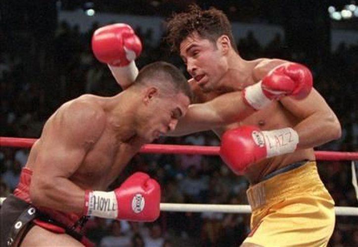 El 'Macho' Camacho en un combate contra Oscar de la Hoya el 13 de septiembre de 1997. (Agencias)