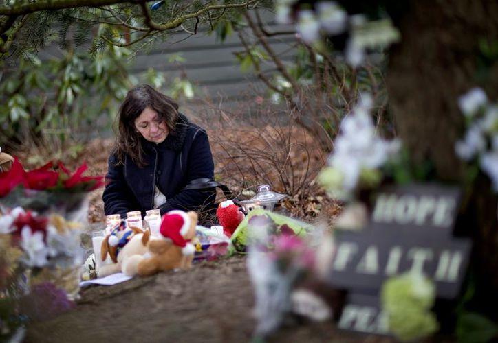 Por respeto a las víctimas de Connecticut, y por abordar la historia de una matanza, fue suspedido el estreno de la película Jack Reacher. (Agencias)