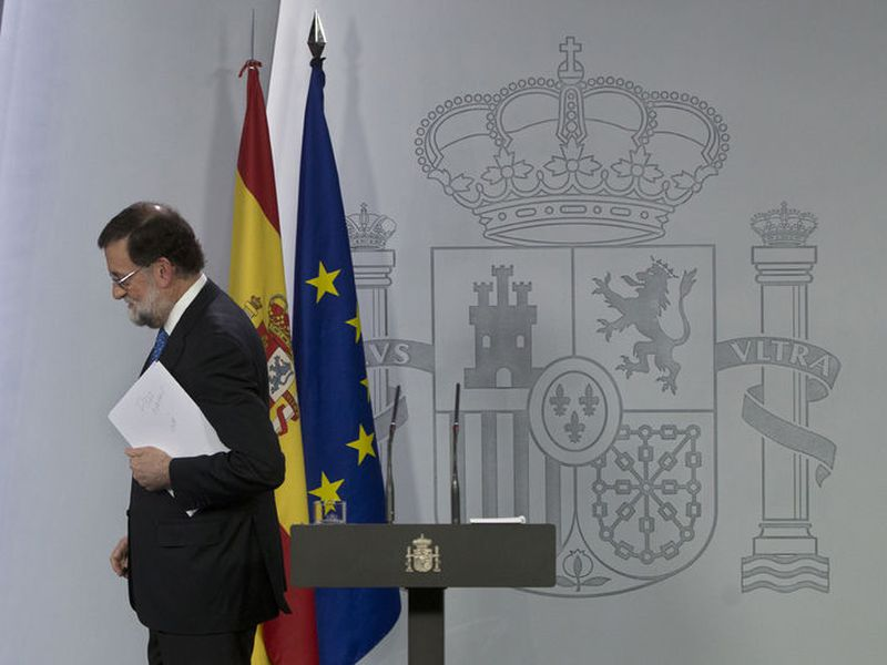 Mariano Rajoy leaves after a news conference in Madrid, Spain.