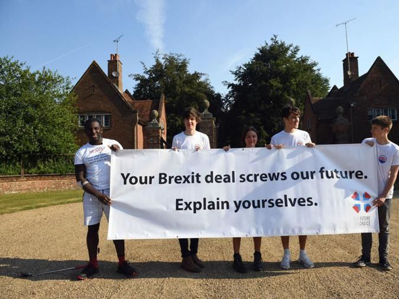 Anti-Brexit activists from Our Future Our Choice stand outside Chequers, in Buckinghamshire, England. (AP)