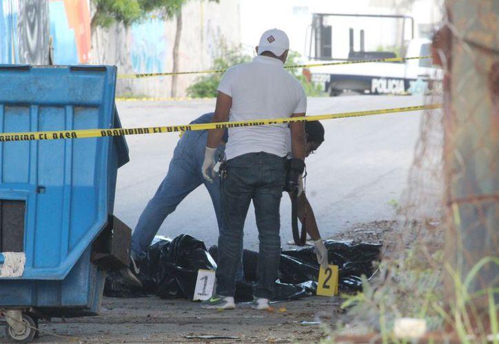 Los cuerpos fueron encontrados por vecinos de la zona, alrededor de las 6:47 horas. (Redacción/SIPSE)