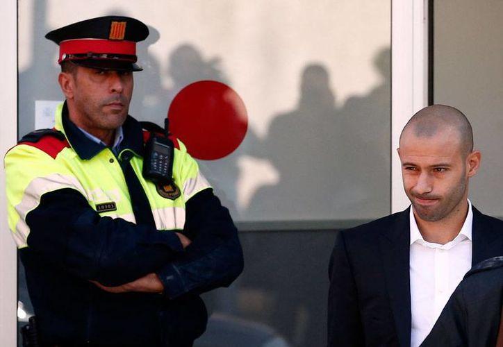 Javier Mascherano, jugador del FC Barcelona, aceptó su responsabilidad en la evasión del pago de impuestos en España. (AP)