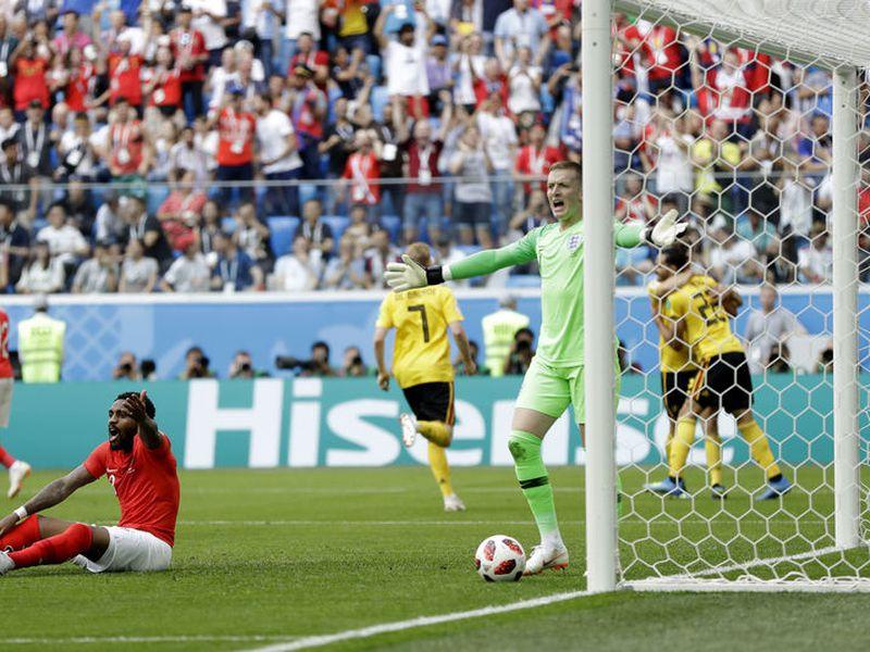 Jordan Pickford salvó lo que parecía el segundo gol de los Diablos Rojos (Foto AP)