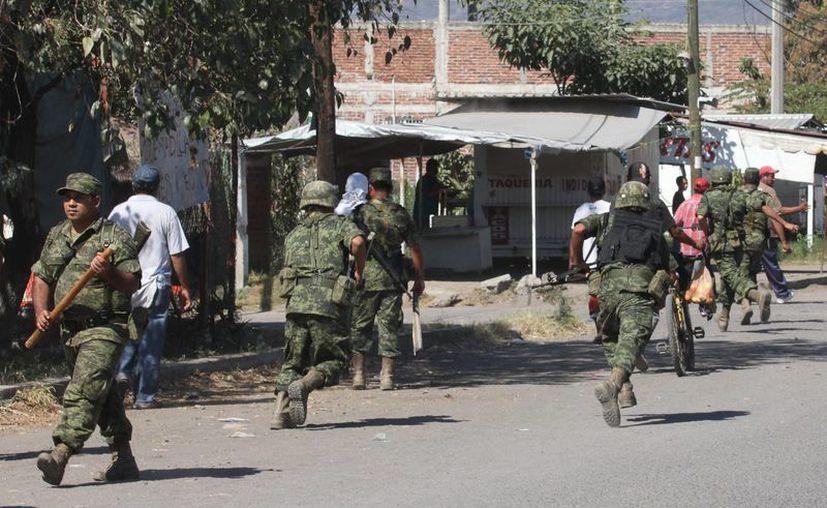 La situación de violencia en Apatzingán es crítica para los comerciantes y empresarios. (Notimex/Foto de contexto)