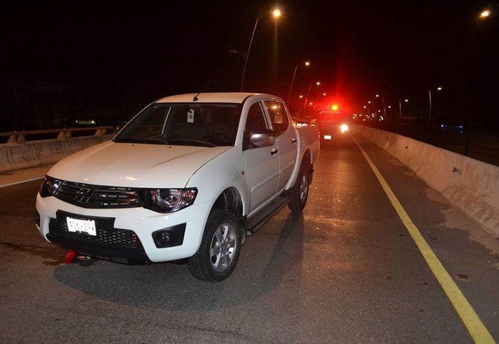 La camioneta en la que se trasladaban los tres sujetos detenidos, pertenece a la Dirección de Zofemat.  (Redacción/SIPSE)