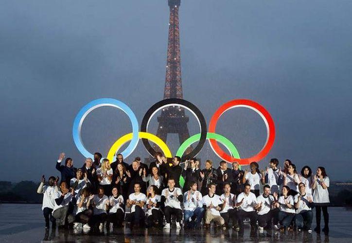 Ahora, ambas ciudades serán sedes olímpicas por tercera vez.  (AP)