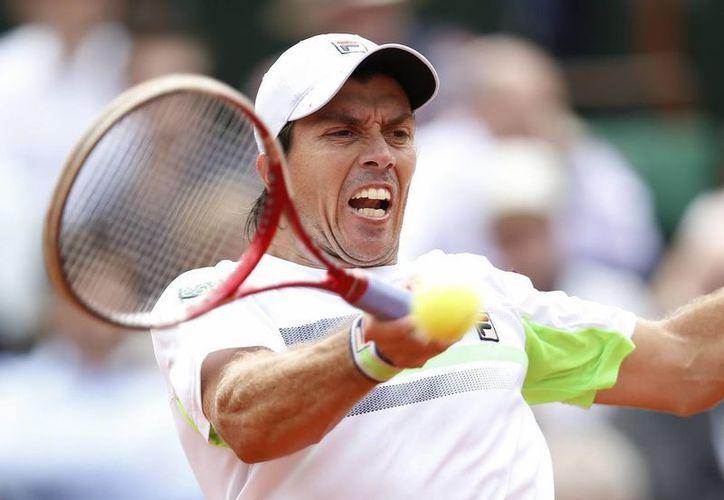 Berlocq cayó en Wimbledon ante el ucraniano Sergiy Stakhovsky por 6-3, 6-3 y 6-3. (EFE)