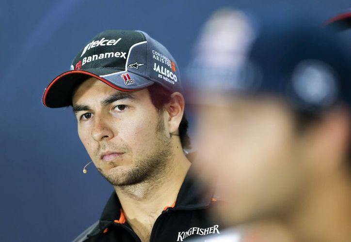 A poco de que inicie el Gran Premio de Barein, el piloto mexicano Sergio Pérez no ocultó su frustración por el auto de carreras que utiliza con la escudería Force India. (EFE)