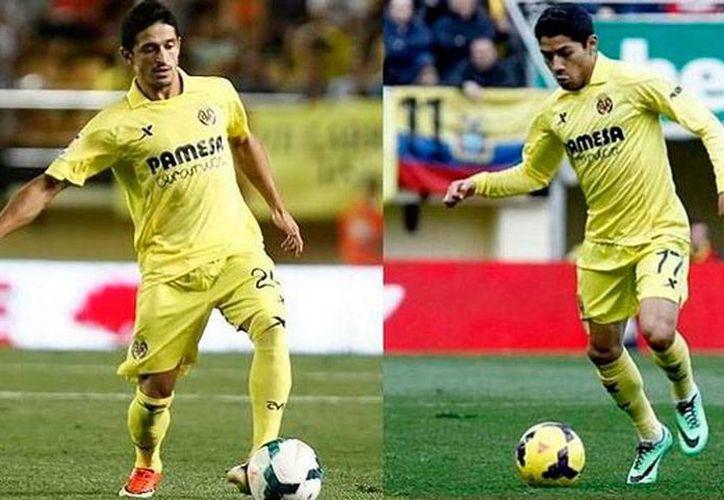 Jonathan Pereira (izq.) y Javier Aquino jugarán esta temporada, en la Liga de las Estrellas, en el Rayo Vallecano, tras un acuerdo firmado entre el club de Madrid y el Villarreal, donde militan ambos jugadores. (Twitter@RVMOficial)