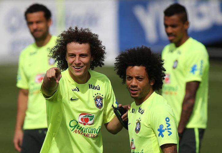 Los jugadores brasileños no se preocupan por las importantes ausencias, pues aseguran que su mente solo está en Alemania. (AP)