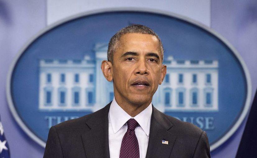 El presidente Obama firmó la orden que prohibe relaciones comerciales con Corea del Norte. (EFE)