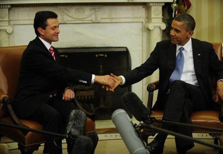 Barack Obama (d) se reunirá con Enrique Peña Nieto en los primeros días de mayo. (Archivo Agencias)