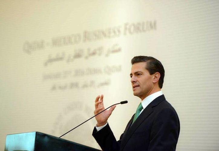 Imagen del presidente Enrique Peña Nieto durante su participación en el Foro de Negocios México-Qatar. El Mandatario copresidirá el Grupo de Alto Nivel sobre el Agua. (facebook.com/EnriquePN)