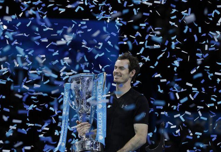El tenista escocés Andy Murray se convirtió este domingo en campeón de la Copa Masters por primera vez en su carrera. (AP)