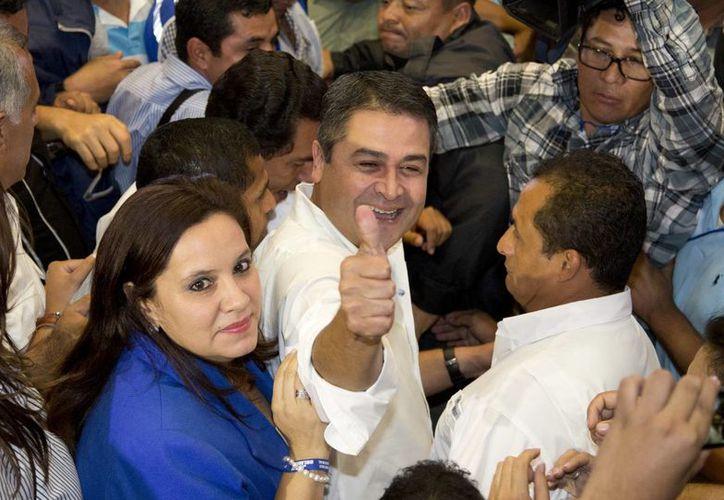 Juan Hernández, del partido oficialista, es el virtual ganador de las elecciones presidenciales en Honduras, según el Tribunal Supremo Electoral. (Agencias)
