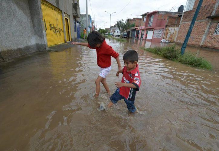 La Secretaría de Salud asegura que, a pesar de las inundaciones, en las zonas afectadas no se han registrado brotes epidemiológicos. (Archivo Notimex)