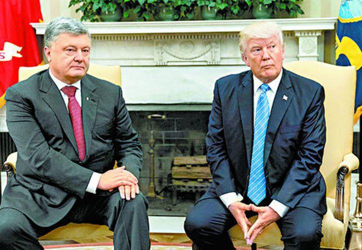 La reunión entre presidentes tuvo lugar en la Casa Blanca. (Nicholas Kamm/AFP)