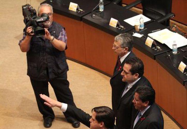 Los nuevos ministros, al momento de tomar protesta. (Notimex)