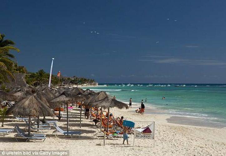 La pareja, John y Tamra Turpin se encontraban de vacaciones en Playa del Carmen. (Cortesía/Daily Mail)
