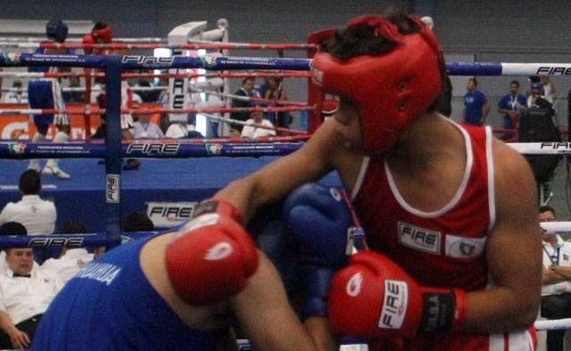El yucateco Abel Rueda obtuvo el oro en la categoría infantil mayor. (Milenio Novedades)