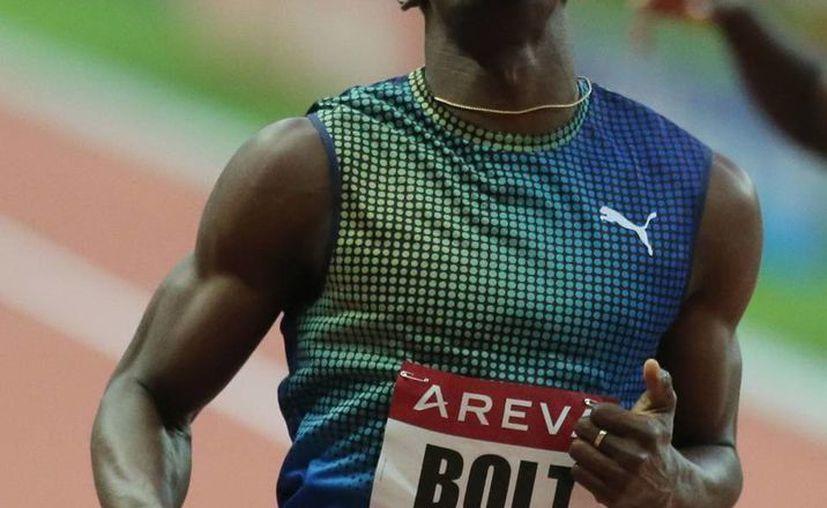 """Bolt está agradecido con Puma porque """"siempre me han respaldado, especialmente en los primeros años"""". (Agencias)"""