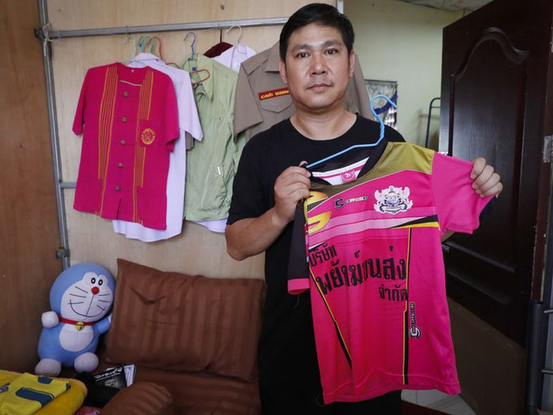 Banphot Konkum, father of Duangpetch Promthep, one of the rescued Thai boys, shows his son's soccer jersey during an interview at their home in Mae Sai district, Chiang Rai province, northern Thailand. (AP)