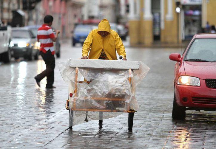 Para este fin de semana se esperan lluvias sobre la Península de Yucatán, además de altas temperaturas. (Archivo/ Notimex)