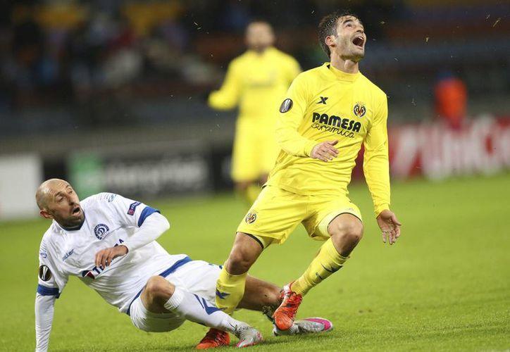 Villarreal, donde juega el mexicano Jonathan dos Santos, ganó  2-1 sobre Dinamo Minsk y ahora es segundo lugar de su grupo en la Europa League. (EFE)