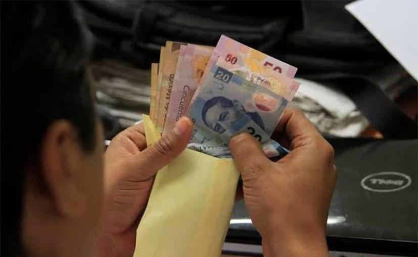 Mujer es acusada de no pagar un préstamo.(Foto: Novedades Yucatán)