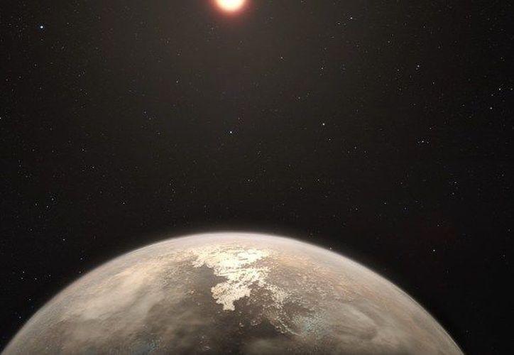 Ilustración artística que muestra el planeta Ross 128 b con su estrella madre enana roja de fondo. (Foto: ESO / M. Kornmesser)