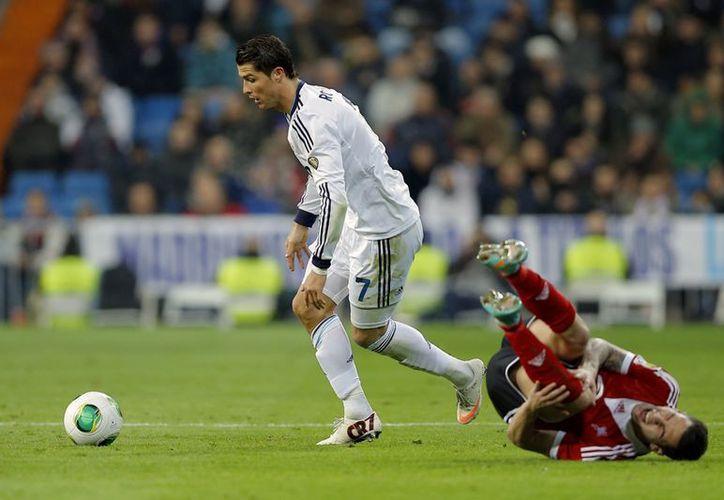 Cristiano volvió a echarse al hombro al Real Madrid, que avanzó a los cuartos de final de la Copa del Rey. (Agencias)