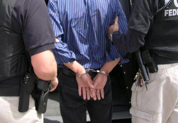 'Menace' podría enfrentar cadena perpetua por los crímenes que se le imputan. (Imagen referencial/Archivo/EFE)