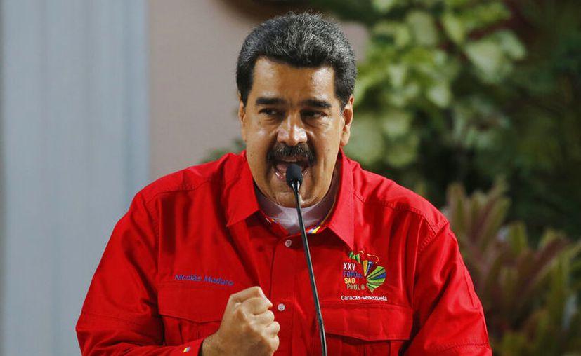 """Maduro manifestó que las declaraciones de Trump denota """"desesperación"""". (AP Photo/Ariana Cubillos)"""