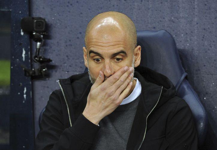 Tras su derrota, en el túnel de los vestuarios, Guardiola se encaró con el director técnico del Wigan Athletic. (Foto: Vanguardia MX)