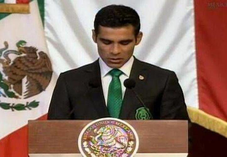 El capitán de la selección de México, Rafael Márquez, en imagen de su discurso en Palacio Nacional antes de viajar a Brasil. (milenio.com)