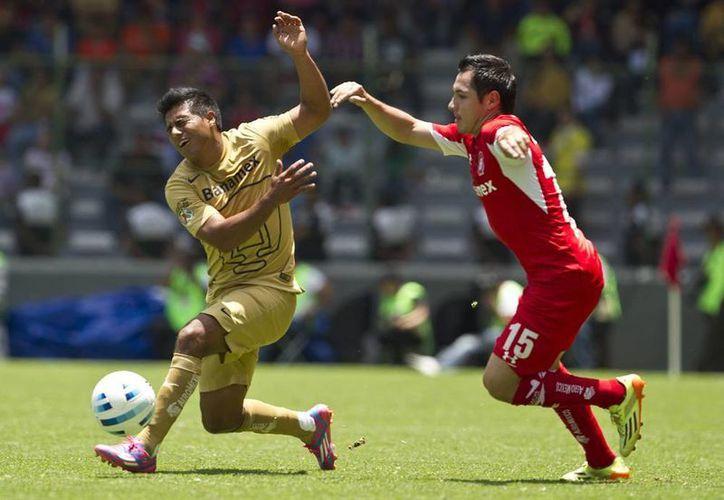 Diablos Rojos materialmente 'devoró' a los felinos universitarios en lo que es su primera victoria del Apertura 2014. (AP)